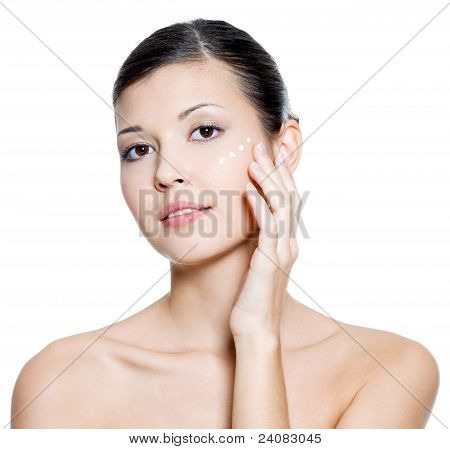 Adult  Woman Applying Cosmetic  Cream Around The Eye