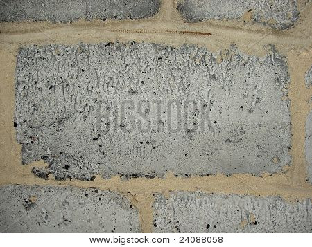 texture (background) building block made ??of slag (ash) is laid into the wall