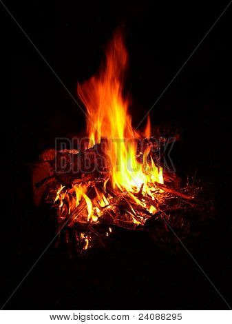a fire burning at night with flames