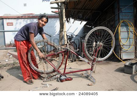 Mechanic Repair The Tire On A Bicycle