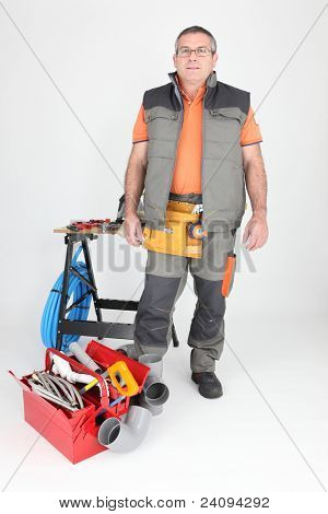 Workman with plumbing equipment and tools