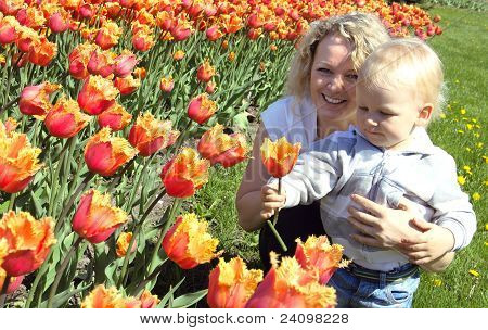 mother and child picking a flower