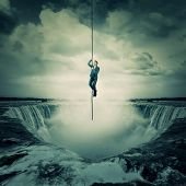 Businessman Salvation, Surviving The Storm Buiness Concept As A Scared Man Hanging On A Chain Escape poster