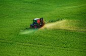Farm Machinery Spraying Insecticide To The Green Field, Agricultural Natural Seasonal Spring Backgro poster