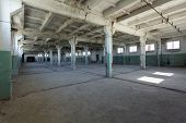 Empty Industrial Warehouse Or Commercial Area In An Architectural Background With Bare Cement Walls, poster