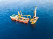 Aerial View Of Tender Drilling Oil Rig (barge Oil Rig) In The Middle Of The Ocean poster