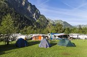 Camping In The  Alpine Mountains . Tourist Tents And Lodges In The Background Of Mountains. Summer I poster