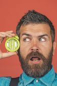 Surprised Excited Bearded Man Hold Alarm Clock Near Face. Bearded Man With Alarm Clock On Red Backgr poster