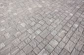Постер, плакат: Stone Pavement In Perspective Stone Pavement Texture Granite Cobblestoned Pavement Background Abs