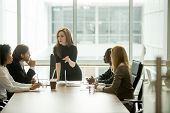 Serious Woman Boss Scolding Employees For Bad Results Or Discussing Important Instructions At Multir poster