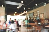Blurred Cafe Or Restaurant With People Are Sitting On Table Enjoy Eat And Drink And Bokeh Background poster