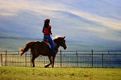 pic of horse riding  - An Asian girl riding a horse returning home - JPG