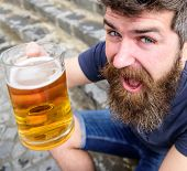 Guy Raising Up Glass With Draught Beer. Hipster On Cheerful Face Drinks Beer Outdoor. Celebration Co poster
