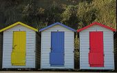 pic of beach hut  - three old beach huts in red - JPG