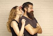 Couple In Love Hug On White Brick Wall. Man With Beard And Woman With Long Blond Hair. Hipsterism, S poster