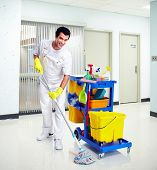 stock photo of janitor  - Young professional cleaner washing the floor - JPG