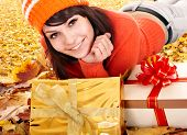 stock photo of fall leaves  - Girl in autumn outdoor holding gift box - JPG