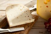 Dutch Hard Cheese Maasdam Or Emmentaler, Cheese With Holes And White Hard Goat Cheese With Coriander poster