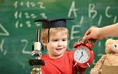 Kid Boy In Academic Cap Near Clock In Male Hand, Classroom, Chalkboard On Background. School Break C poster