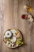 Cheese Plate Assortment Of French Cheese Served With Honey, Walnuts, Bread And Grapes On Ceramic Pla poster