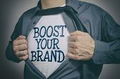 Man Showing Boost Your Brand Tittle On T-shirt poster