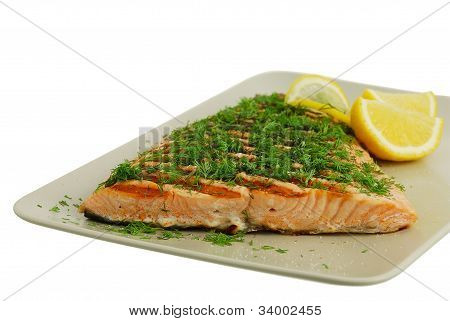 Salmon Fish Fillet Grilled With Green Vegetables And Lemon