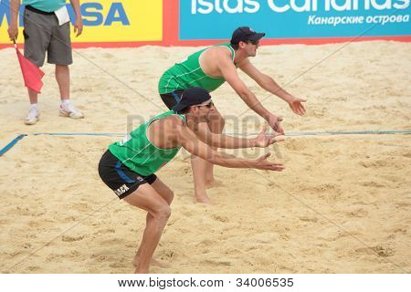 MOSCOW, RUSSIA - JUNE 8: Thiago-Ferramenta, Brazil vs Christopher McHugh (further) and Joshua Slack (closer), Australia, during Beach Volleyball Swatch World Tour in Moscow, Russia at June 8, 2012
