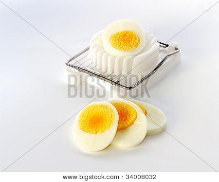 An Egg Slicer And Sliced ??egg