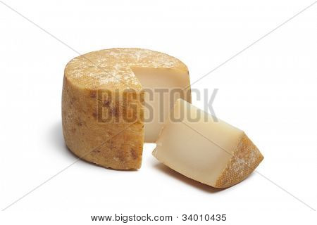 Traditional Basque sheep's milk cheese on white background