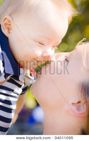 Joyful Baby Rubbing Noses With Mom
