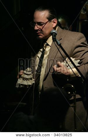 MADISON, NJ - JUNE 16: Steve Turre holds two conch seashells as he performs with his Quartet at Shanghai Jazz on June 16, 2012 in Madison, NJ.