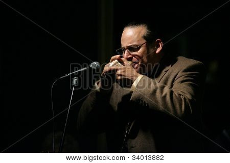 MADISON, NJ - JUNE 16: Steve Turre blows into a conch seashell as he performs with his Quartet at Shanghai Jazz on June 16, 2012 in Madison, NJ.
