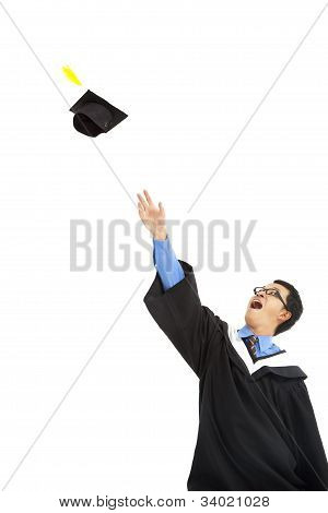 happy graduating student throwing the cap