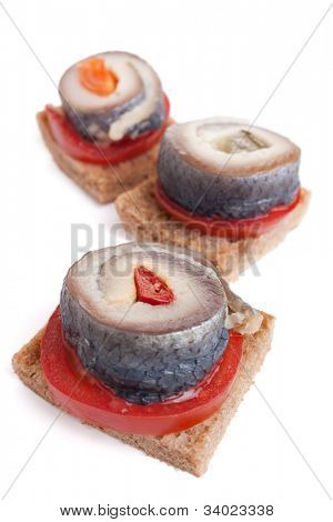 sandwiches with tomato and norwegian herring