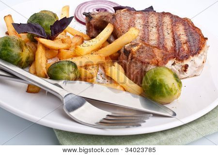 pork chops with french fries and brussels sprouts