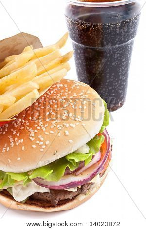 cheeseburger, french fries and cola on white background