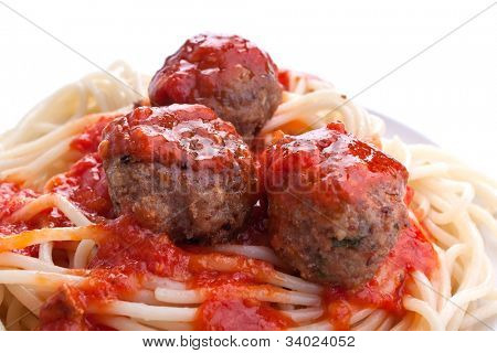 spaghetti with three meatballs in tomato sauce