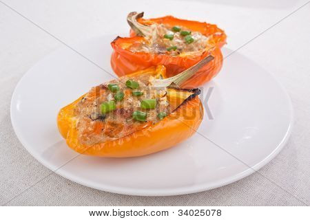 peppers stuffed with cheese and mushrooms on a plate