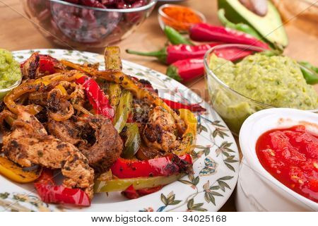 mexican dish with chicken, beef and vegetables