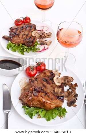 servings of pork chop with mushrooms and vegetables