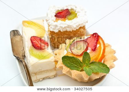 group of fruit tarts on a dish