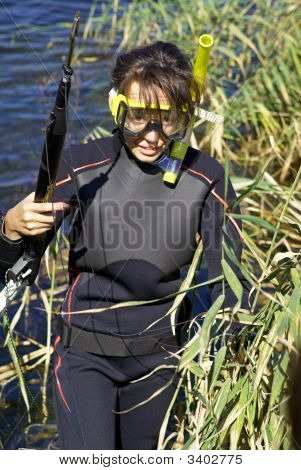 Underwater Diver Girl In Lake