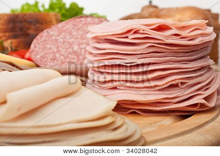 big group of meat, bread and vegetables