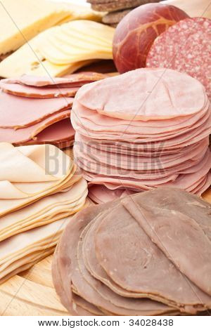 big group of thinly sliced meat on white background