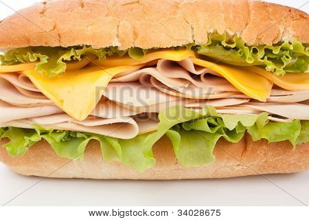 tasty turkey breast, cheese and lettuce sandwich