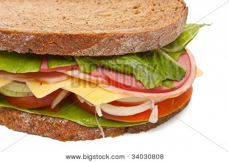 healthy meat, lettuce, cheese and vegetables big sandwich on toasted brown bread