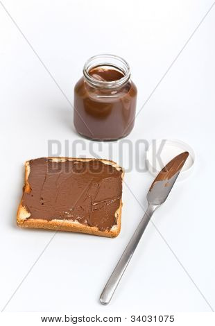 open chocolate spread container with a buttered toast and a knife