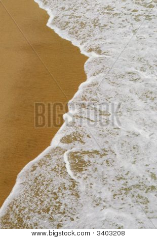 Gentle Waves On Sandy Beach