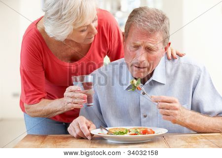 Senior woman looking after sick husband