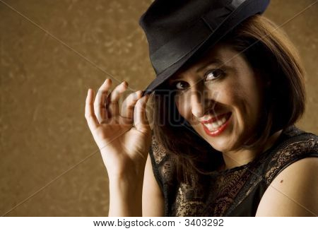 Hispanic Woman Tipping Her Hat